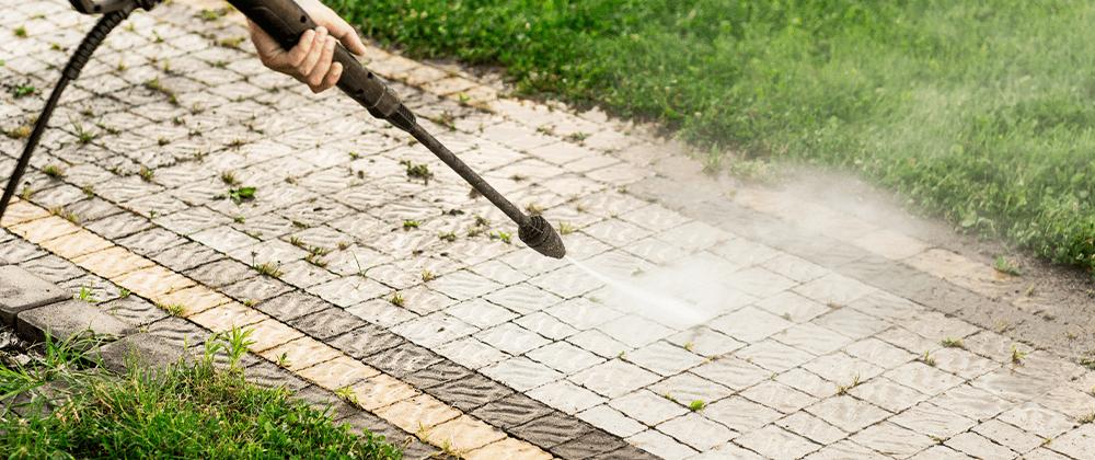 pressure washing a walkway clean