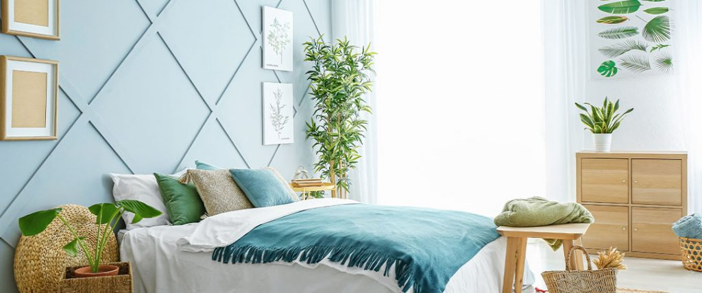 bedroom with sunlight and houseplants